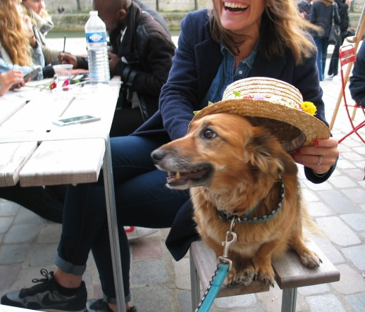 Ideale smiling with hat on the berges de seine by Paige Donner